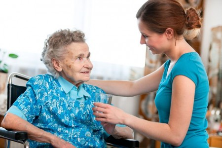 14456383 - senior woman with her caregiver at home