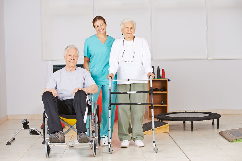 37735248 - two senior people with nurse during physiotherapy in a nursing home