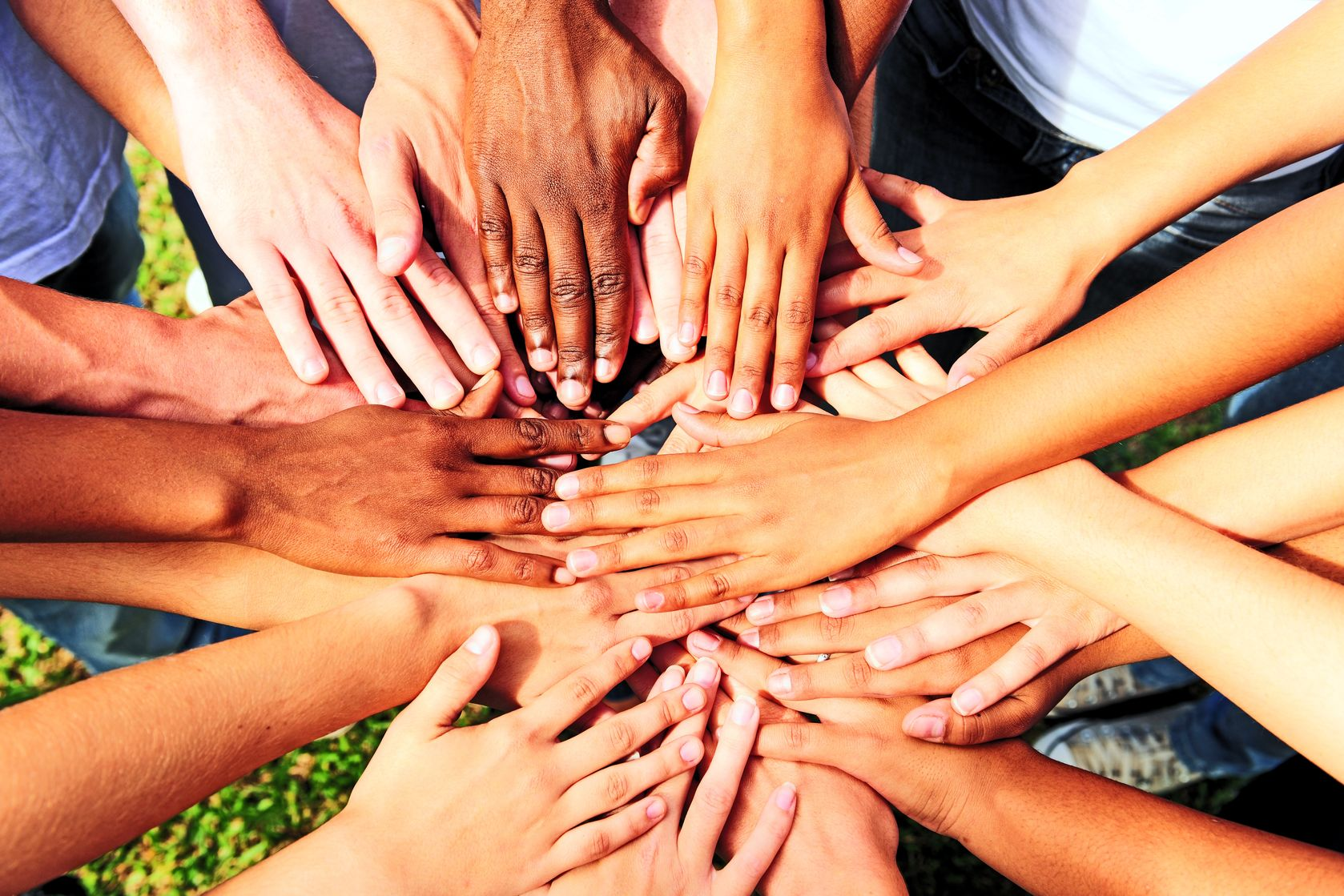 9477132 - many hands together: group of people joining hands showing unity and support